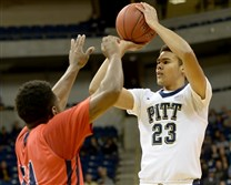 Pitt's Cameron Johnson gets a shot up against Detroit's Jaleel Hogan in the first half Friday night at the Petersen Events Center.