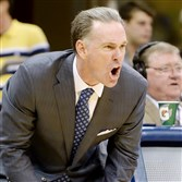 Pitt head coach Jamie Dixon calls out a play to his team against Detroit in the second half Friday night at the Petersen Events Center.