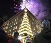 The crowd takes in the fireworks display during last year's Light Up Night festivities in Downtown Pittsburgh.