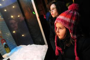 Adeline Waldrup, 7, of Friendship and her sister Ila, 4, take in the Macy's holiday window display.