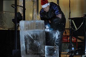 Richard Bubin of Ice Creations makes his initial cuts in a block of ice during Light Up Night festivities Downtown.