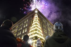 The Highmark Unity Tree lighting is accentuated with rooftop fireworks on Light Up Night in Downtown Pittsburgh on Friday.