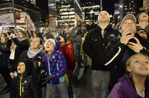 The crowd takes in the fireworks during the lighting of the Highmark Unity Tree during Light Up Night in Downtown.