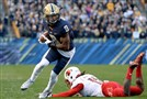 Pitt's Jordan Whitehead eludes a Louisville defender his freshman year at Heinz Field.