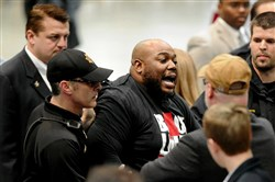 A protester is removed by security as Republican presidential candidate Donald Trump speaks during a campaign stop on Saturday in Birmingham, Ala.