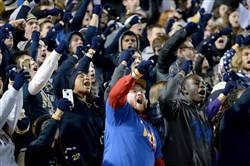 "The student section sings ""Sweet Caroline"" at the end of the third quarter of Pitt's November game against Louisville at Heinz Field."