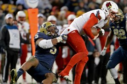 Pitt's Ejuan Price takes down Louisville quarterback Kyle Bolin in the second quarter Saturday at Heinz Field.