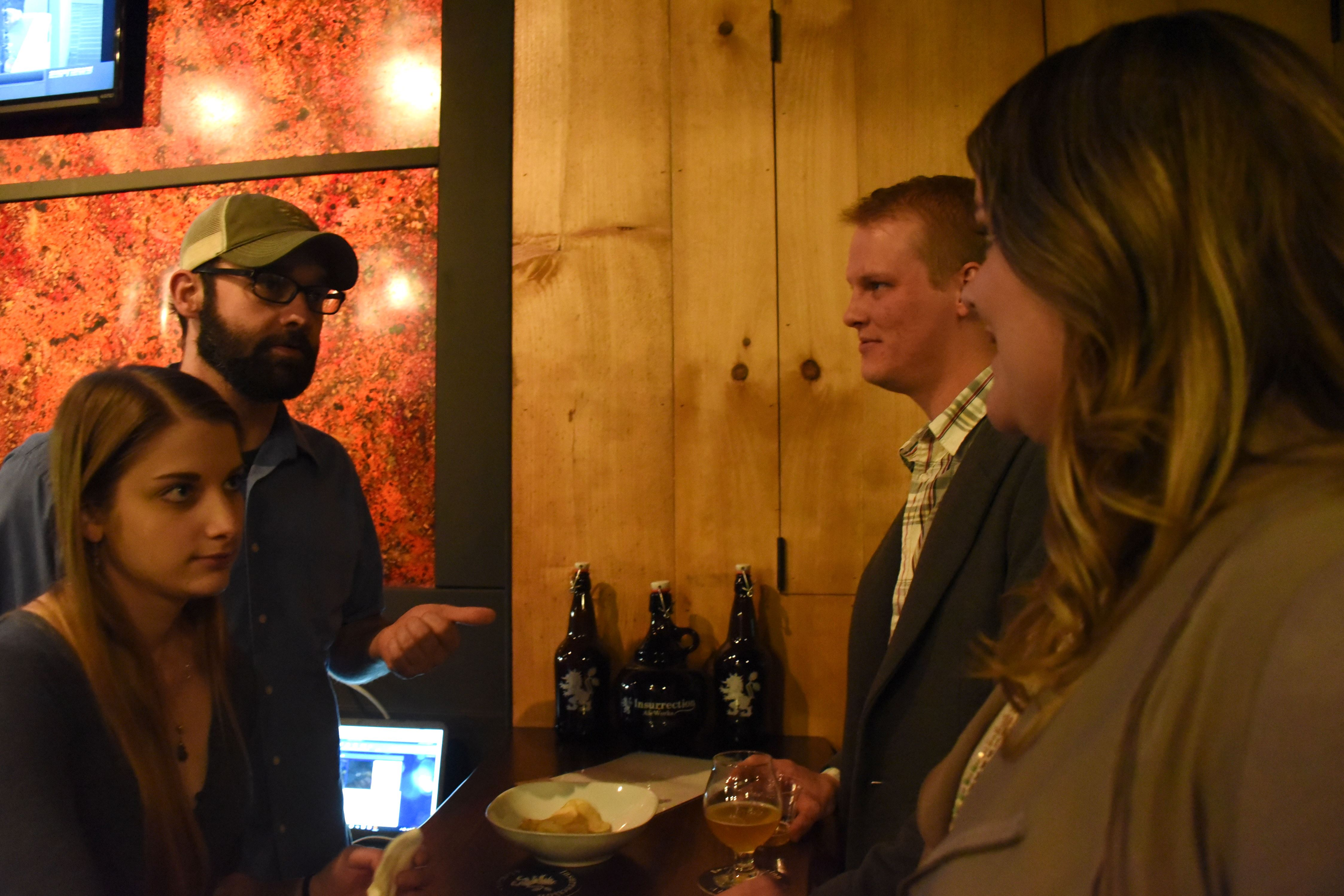 20151121KJInsurrectionAleworksOpening5-4 From left, Jeannie Hatok, Brad Primozic, Jake Morrison and Meghan Carlson have a conversation at the end of the bar during the private opening of Insurrection Aleworks.