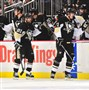 Evgeni Malkin is congratulated by his bench after scoring a goal against the Colorado Avalanche during the game at Consol Energy Center on November 19, 2015 in Pittsburgh. To Malkin's left is linemate Phil Kessel.