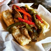 "The ""Playground"" -- a Chicago-style marinated Italian beef sandwich with sauteed peppers on a Breadworks bun at the Old School Italian Sandwich Shop in Munhall."
