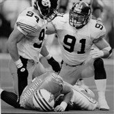 Steelers Chad Brown, left, and Kevin Greene celebrate after sacking Oilers quarterback Chris Chandler. Greene ranks third all time in sacks, first among linebackers, yet still doesn't have a spot in the Hall of Fame.