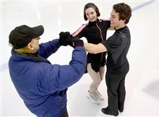 Bob Mock, an instructor for Ice & Blades Figure Skating, gives a lesson to R.J. Springer of Raccoon and Jessica Wasik of Aliquippa at the Alpha Ice Complex in Harmar.