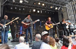 The Doobie Brothers, left to right, John Cowan, Patrick Simmons, Tom Johnston, John McFee and Tony Pia perform in New York City in June 2013.