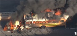A school bus catches fire following a chase along I-676 in  Philadelphia in which a vehicle rear-ended the bus and then shot a state trooper in the shoulder.