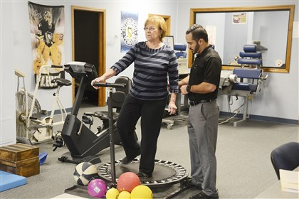 Margaret Cerra works on uneven surfaces with the guidance of physical therapist Mike Tardio during her third week of therapy after having hip replacement surgery at AGH.