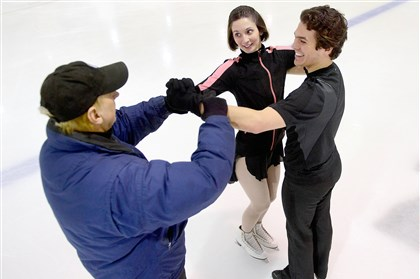 Bob Mock, an instructor for Ice & Blades Figure Skating, gives a lesson to R.J. Springer of Racoon Township and Jessica Wasik of Aliquippa at the Alpha Ice Complex in Harmar.
