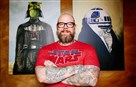 Chef Keith Fuller poses for a photo with Star Wars art at his restaurant Root 174 in Regent Square.