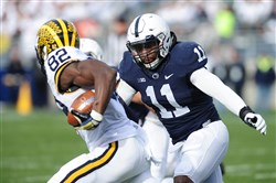 Penn State's Brandon Bell tackles Amara Darboh of Michigan during a game at Beaver Stadium on November 21, 2015 in State College, Pennsylvania.