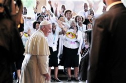 A crowd cheers Pope Francis as he meets with Sahle-Work Zewde, the director-general of the United Nations Office at Nairobi, upon his arrival Thursday at the U.N. regional office in Kenya.