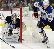 Blues' Dmitrij Jaskin picks up loose puck in front of  Penguins goalie Marc-Andre Fleury in the second period at the Consol Energy Center.