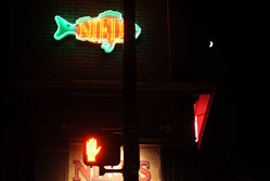 A crescent moon over Nied's Hotel, a bar and restaurant in Lawrenceville, famous for its fish sandwich.