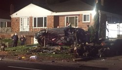 A vehicle is flipped onto its side in a deadly crash early this morning on Penn Avenue near North Lang Avenue in North Point Breeze.