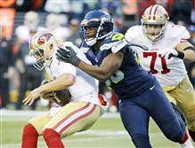 Seahawks defensive end Cliff Avril, center, sacks San Francisco 49ers quarterback Blaine Gabbert in a game last week.