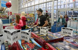 Early holiday shoppers make their way into the Toys 'R' Us in Cranberry.