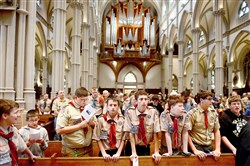 "Boy Scouts and their families listen to a presentation Friday at St. Paul Cathedral in Oakland during a stop on their ""Ten Commandment Hike."""