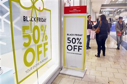 Retailers, like those at The Mall at Robinson, above, are offering discounts to attract holiday shoppers to their stores during Black Friday weekend.