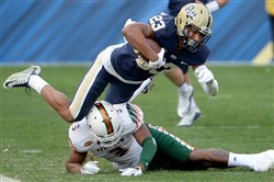 Pitt's Tyler Boyd is stopped by Miami's Tracy Howard in the third quarter today at Heinz Field.