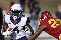 Running back Wendell Smallwood has had a breakout season for a Mountaineers offense that's typically known for its passing.