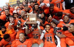 Clairton teammates celebrate with their trophy after defeating Jeannette in the WPIAL Class A championship at Heinz Field. A steering committee has determined that this season's Class 2A and 1A games will not be played at Heinz Field.
