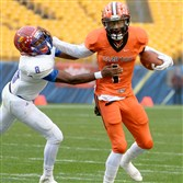 Clairton quarterback Aaron Mathews pushes Jeannette's Mark Wormack away during the WPIAL Class A championship game in November at Heinz Field.