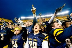 Central Catholic players celebrate after winning last season's WPIAL Class AAAA title at Heinz Field.