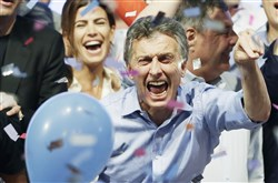 Opposition presidential candidate Mauricio Macri and his wife Juliana Awada, back left, celebrate after winning a runoff presidential election Nov. 22 in Buenos Aires. Mr. Macri won Argentina's historic runoff election against ruling party candidate Daniel Scioli, putting an end to the era of  President Cristina Fernandez, who along with her late husband dominated Argentine politics for 12 years.