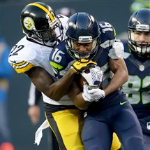 Seahawks receiver Tyler Lockett makes a first-down catch against Steelers cornerback William Gay in Seattle's 39-30 victory Sunday at CenturyLink Field.