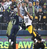 The Seahawks' Kevin Smith pulls in pass for first down yardage against the Pittsburgh Steelers Ross Cockrell on Sunday at CenturyLink Field in Seattle.