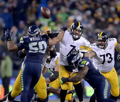 Ben Roethlisberger is pressured Sunday by Seattle's K.J. Wright late in the fourth quarter at CenturyLink Field.