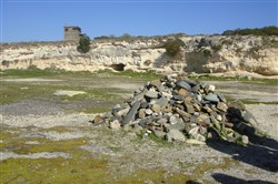 Prisoners worked in the quarry on Robben Island. After his release, Nelson Mandela returned to Robben Island and placed a rock at the quarry. The 1,300 political prisoners at the reunion followed suit and created the cairn as a memorial for their strenuous labor.