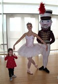 Isabella Eberman, 2, of Whitehall, meets Pittsburgh Ballet Theatre's Sugar Plum Fairy and Nutcracker at Phipps Conservatory.