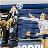 Latrobe grad April Krivoniak, right, a junior on the Robert Morris volleyball team, was named the NEC tournament MVP.