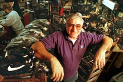 "The last shop and home of the late Benny ""Bucky"" Palermo is for sale. He is shown amid hundreds of athletic shoe he repaired for local high schools as well as the Steelers, Penguins and Pirates."