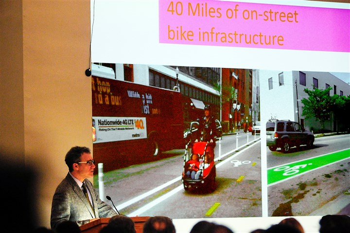 20151201DHCompleteStreetsMeetingLocal-1 City planning director Ray Gastil discusses the exisiting bike infastructure Tuesday at a public meeting addressing Complete Streets for Pittsburgh at Pitt's Alumni Hall.