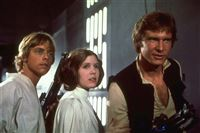 "ADVANCE FOR SUNDAY, APRIL 11--FILE--Mark Hamill, Carrie Fisher, and Harrison Ford, from left, starred in the 1977 film ""Star Wars."" The movie established director George Lucas' genius for applying special effects to adventure. (AP Photo/ho) Original Filename: MIL_HOLLYWOOD_S_CENTURY_BYM.JPG movie still PUBLISHED CAPTION: Ms. Fisher shot to fame in 1977 as Princess Leia in Star Wars, also starring, Mark Hamill, left, and Harrison Ford."