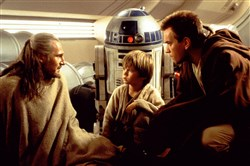 "Talking about their hasty retreat from the planet Tatooine are Jedi Master Qui-Gon Jinn (Liam Neeson), Anakin Skywalker (Jake Lloyd) and Jedi apprentice Obi-Wan Kenobi (Ewan McGregor), as droid R2-D2 listens in ""Star Wars: Episode I - The Phantom Menace."""