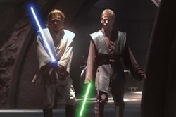"Jedi Obi-Wan Kenobi (Ewan McGregor) and his apprentice, the powerful young Anakin Skywalker (Hayden Christensen), prepare to confront Count Dooku at a secret hanger on the planet Geonosis in ""Star Wars Episode II Attack of the Clones."""