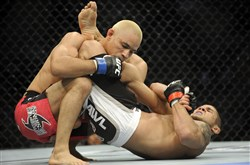 Javier Vazquez, left, fights Joe Stevenson during UFC action at Consol Energy Center in June 2011.