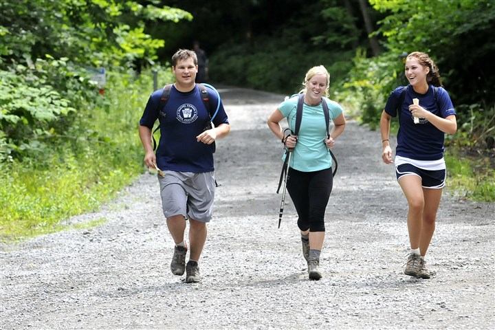 Rachel Carson Challenge Running as they leave Agan Park in Springdale are, from left, John Bongiovanni of Aspinwall, Kate Bender of Fox Chapel, and John's sister Dana Bongiovanni of Allison Park, as they take the 16-mile option during the annual Rachel Carson Trail Challenge in 2009.