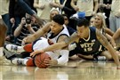 Former Duquesne guard Jeremiah Jones dives for a loose ball against Pitt last season in the City Game. Jones will now join the Dukes coaching staff as a graduate assistant.
